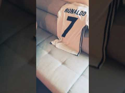 Real Madrid fan cries during taking t-shirt off from small Ronaldo